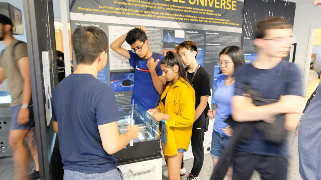 Students watch particle trails in the Cloud Chamber Particle Detector, available on display at the MI Visitor Centre.