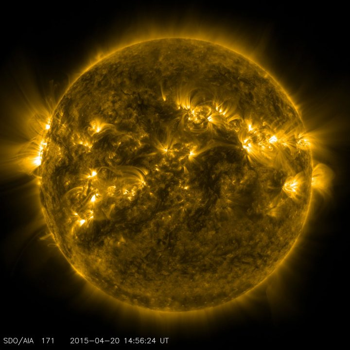 An image of the sun showing a tumultuous, dynamic surface. There are bright spots in yellow/gold, and darker black areas.